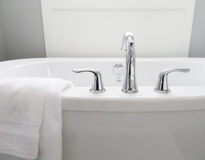 ceramic bathtub with hot and cold chrome faucet